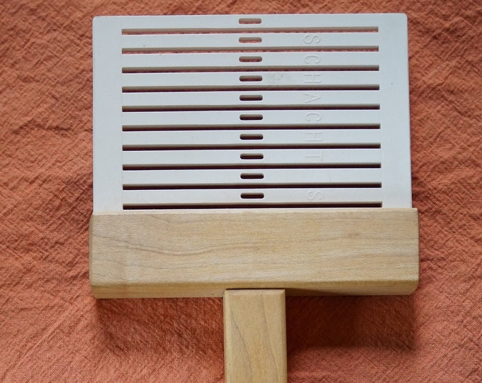 Schacht warping paddle