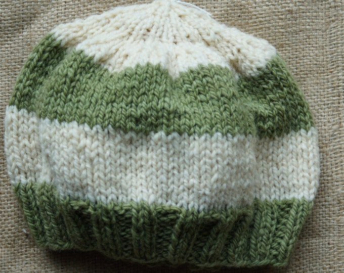 Green & Natural wool hand dyed child or small adult hand knit hat from our farm yarn