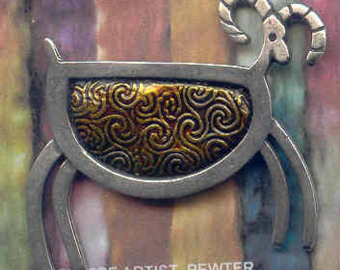 Brooch: GOLD pewter petroglyph sheep brooch.