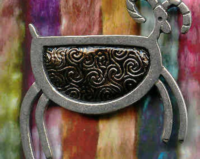 Brooch: Black petroglyph pewter sheep brooch