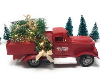 red metal retro christmas truck with trees lights and wreath farmhouse red truck red truck decor