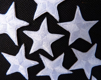 """White star patches > embroidered > iron-on > 1"""" (25mm) from point to point > hand finished"""