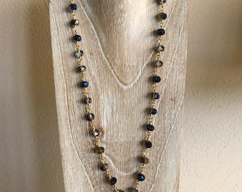 Necklace in rough emerald stones