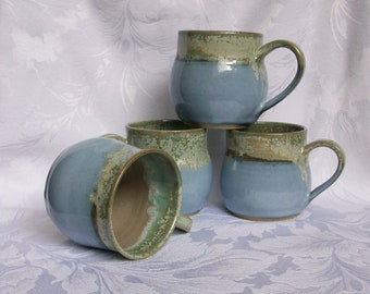 Set of 4 blue and mint, round bellied coffee mugs.