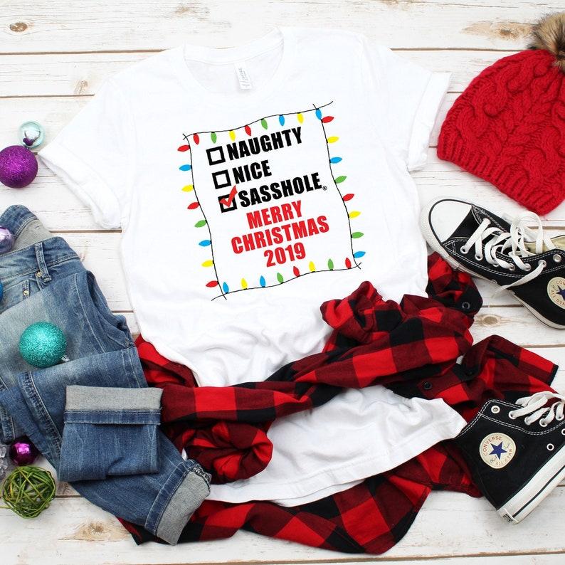 Are you NAUGHTY NICE or a SASSHOLE® Unisex Christmas T-Shirt image 0