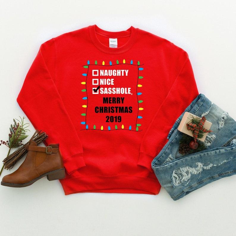 Are you NAUGHTY NICE or a SASSHOLE® Unisex Sweatshirt S-2XL image 0