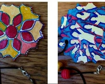 Beautiful  unique hand made, hand painted ceramic pendants with clasped cord chain