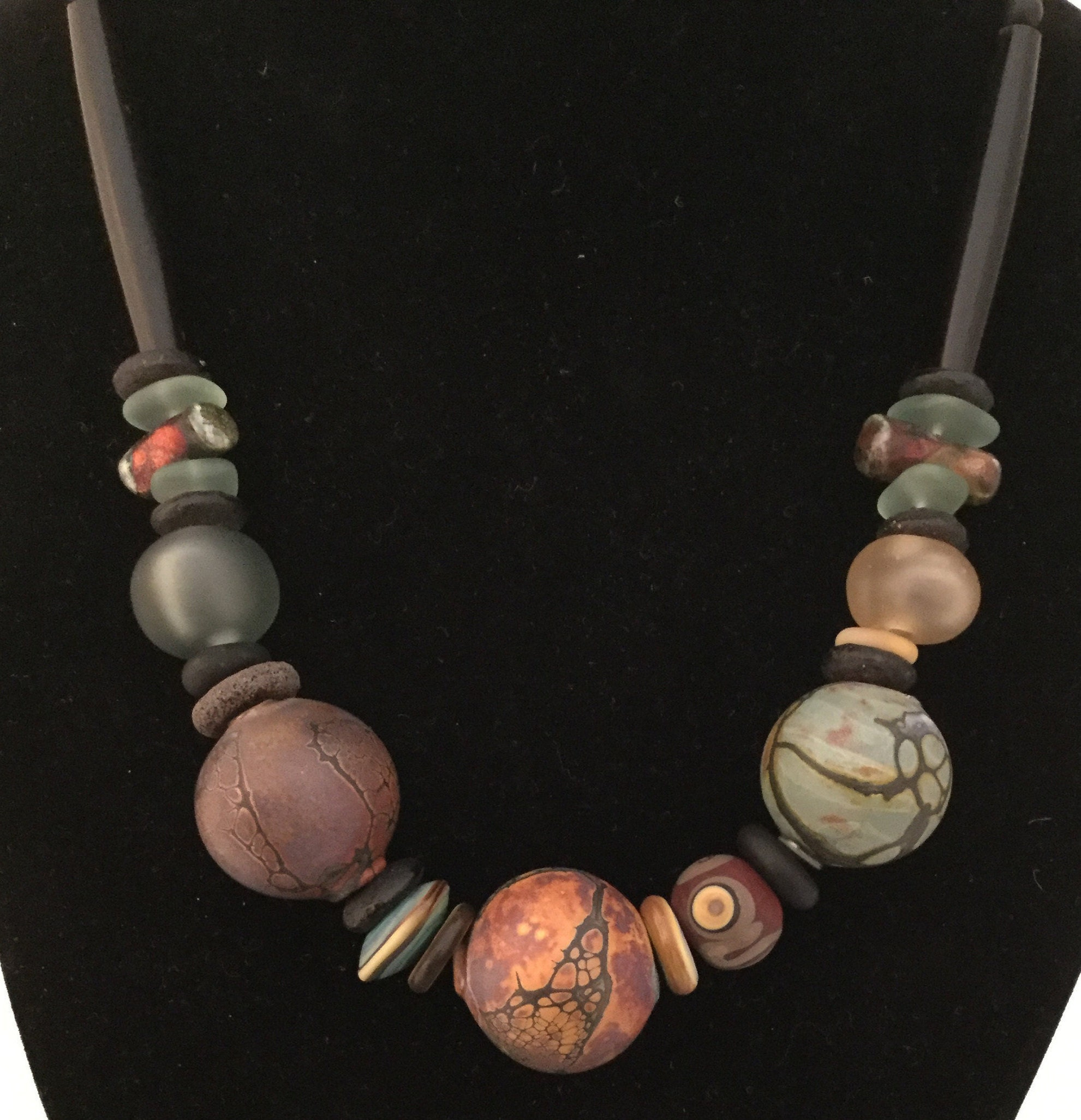 Stunning Artisan Ceramic Beads Accented By Raku Glass And Black Bone Pipe Shaped Beads