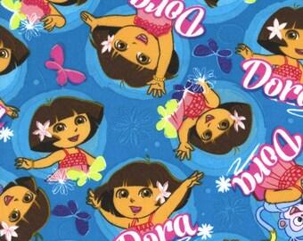 Nickelodeon fabric, Dora fabric: Dora The Explorer Dancing on Blue 100% cotton fabric by the yard  (SC558)