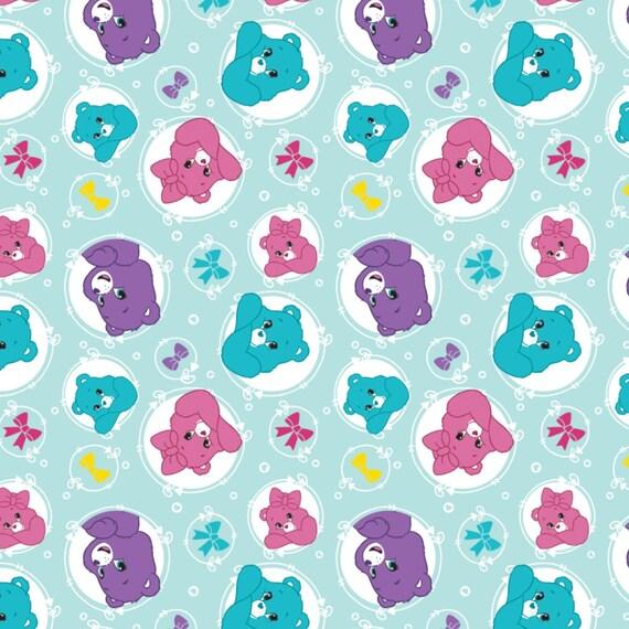 Carebear Fabric, Care Bear Fabric: NEW Camelot Care Bear Sparkle & Shine Arrows AQUA BLUE  100% cotton fabric by the yard (CA922)