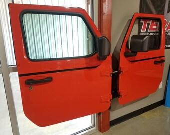 Wall mounted Jeep door hanger. Single door holder holds 2 doors