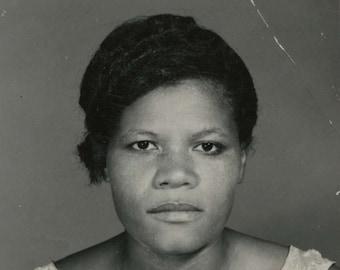Vintage 1960's British studio portrait photograph of a young woman