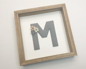 Fabric letter with flowers in a wooden frame (many colours mgl.) as children's room decoration