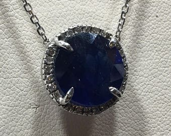Natural sapphire pendant surrounded by tiny diamonds or a 14 karat gold chain