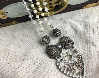 Love, Me.  Vintage assemblage necklace, heart, bow, rosary, altered, rhinestone