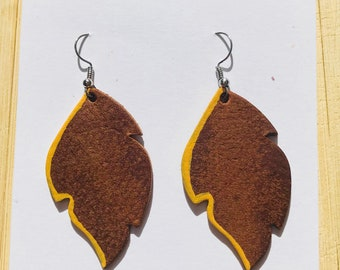 Brown leather leaf earrings with mustard yellow detail
