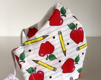 Teacher Print Reusable Face Mask. Free Shipping. Wire Nose, Adjustable ear loops, with filter pocket. Apples and Pencils print.