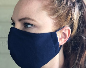 Navy blue Reusable Face Mask with filter pocket, wire nose, and soft adjustable ear loops. Free shipping. Unisex.