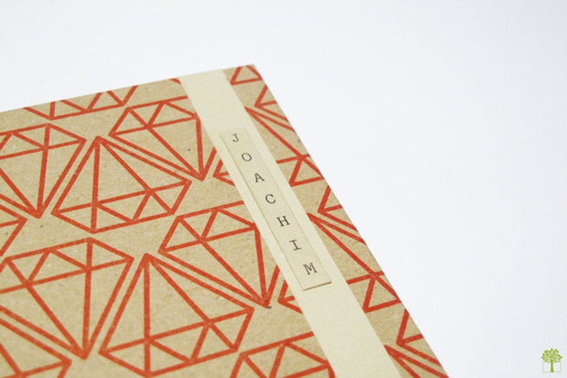 Small paper notebook with geometric patterns beige and white image 0