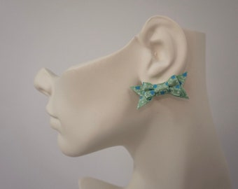 Mint green floral patterned bow earrings