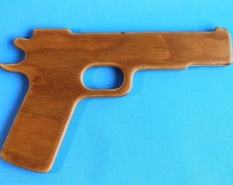 Wooden gun. Children's play guns.