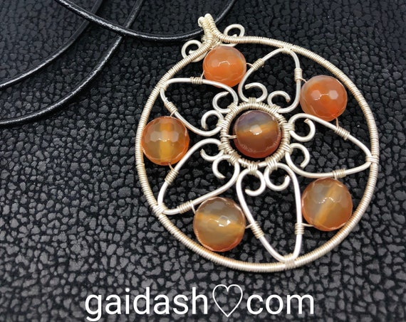 Handmade artisan carnelian stone copper wire charm pendant / necklace. Celestial style jewelry with wire hearts and natural stones.