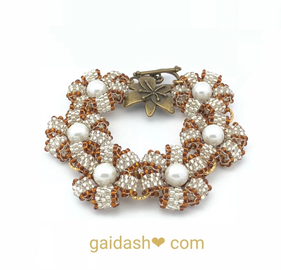 """Delicate Hand Beaded Bracelet with Golden , Silver Beads and White Pearls . Delightful Jewelry Bracelet """"Flowers""""  """"Daisies"""""""