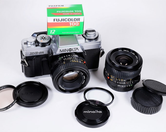 Minolta XG-M 35mm SLR w/ MD 50mm & 28mm Minolta Lenses - All Books, Papers, Filters, Caps, Strap and Flash, Free Film, Super Clean