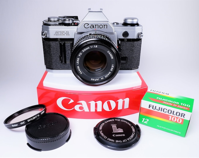 Canon AE-1 35mm 1980 Olympic SLR Film Camera w/ Canon FD 50mm f1.8 Lens - Super Clean and Tested - Includes Caps, New Battery and Fujifilm!