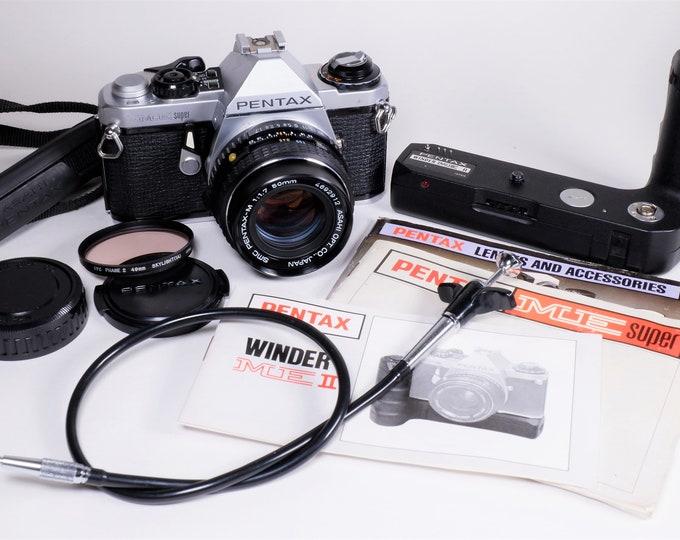 Asahi Pentax ME Super 35mm SLR Film Camera Set w/ Asahi Pentax SMC Pentax-M f1.7 50mm Lens, Power Winder, Books, Filter & Caps - For Repair