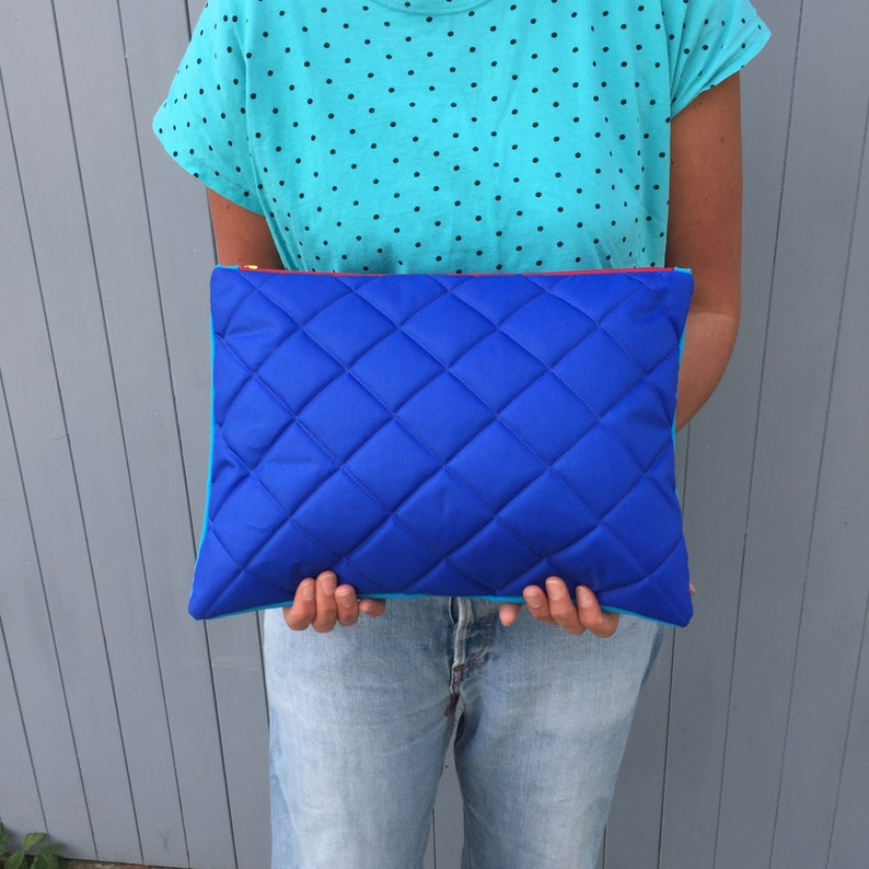 large quilted clutch bag in contrasting fabrics image 0