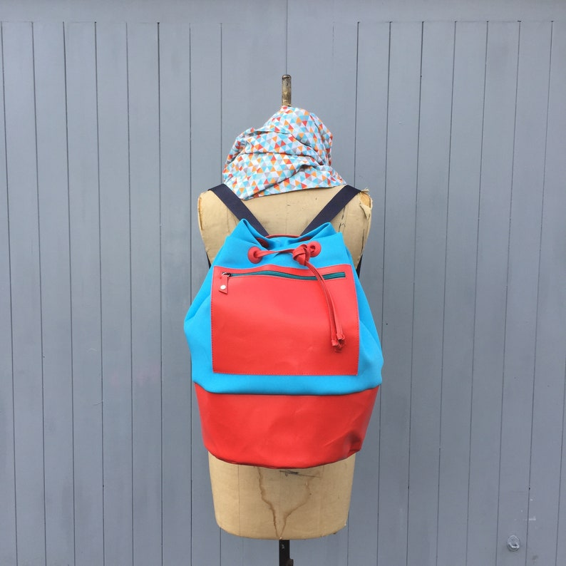 Turquoise and red neoprene and recycled leather duffle bag image 0