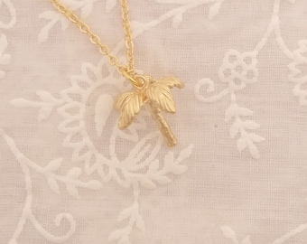 Lovely tropical palm tree charm necklace, gold plated.