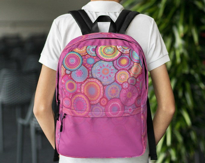 Pink Backpack with colorful patterns