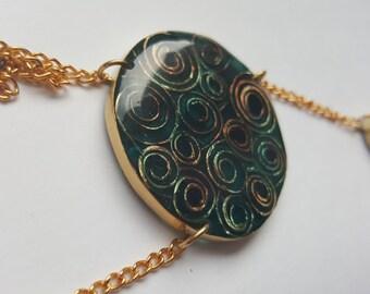Contemporary Spiraling Pendant. brass &resin