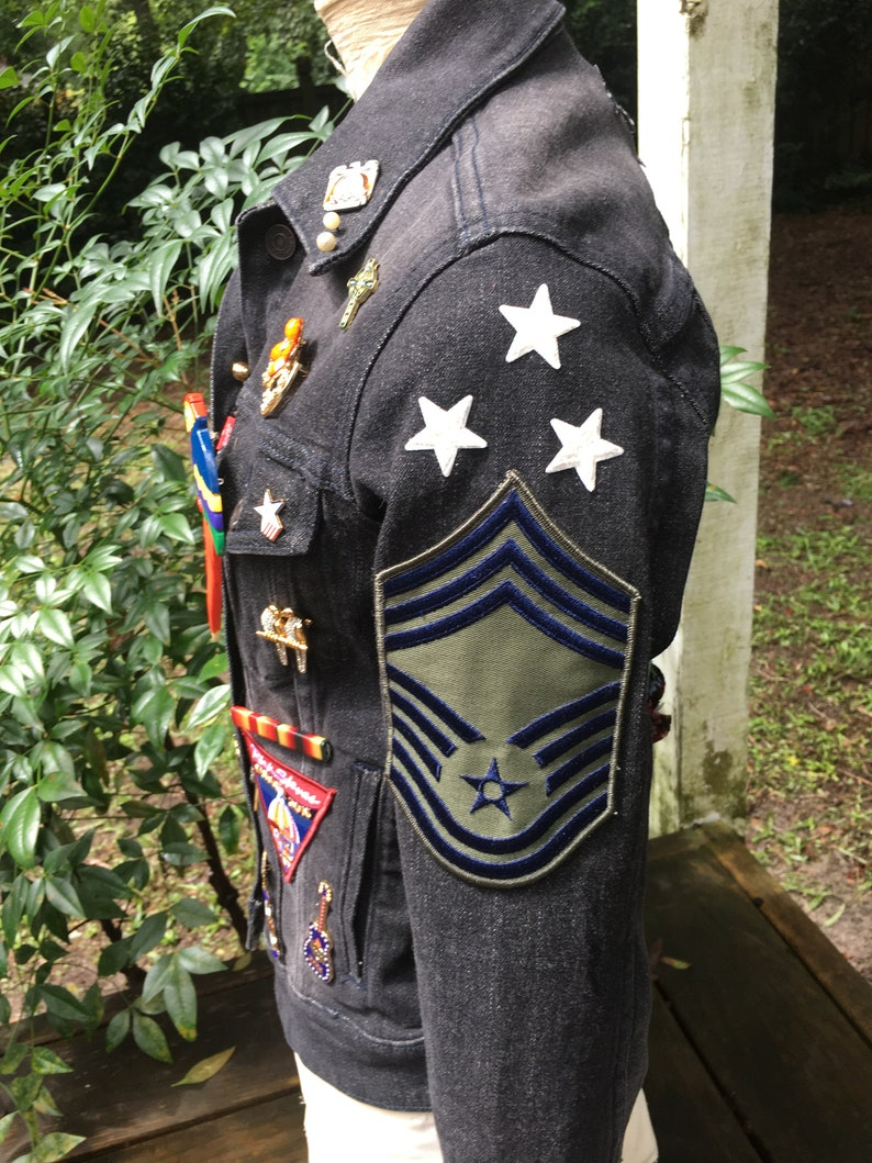 vintage patches pins and jewelry assemblage upcycled JEAN JACKET with antique needlework flowers
