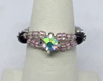 Cubic zirconia stretch ring.  Clear AB, mauve, black, and silver.  Size 7 to 8