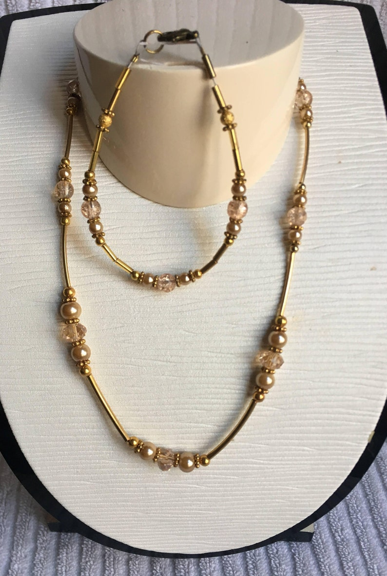 Crystal Classic Beauty and Pearl Necklace and Bracelet Set \u2013 Elegant and Timeless Decadent Gold