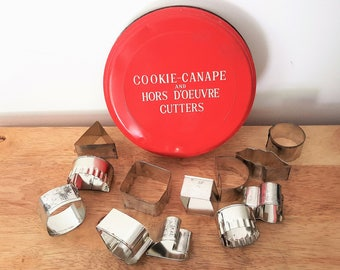 Set of 12 vintage Cookie-Canape and Hors D'Oeuvre Cutters in a metal tin