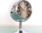 Space Age RHYTHM Retro Vintage ALARM CLOCK 51129 Top Fully Chrome Pedestal Japan Space Age Clock. Offered With a One Years Guarantee