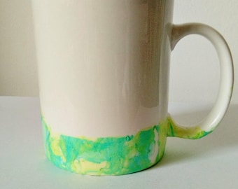 White mug with green and yellow marbling/dip dyed