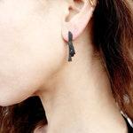 triangular shape post earrings, geometric shape earrings, statement earrings, black earrings, unisex stud earrings, not identical earrings