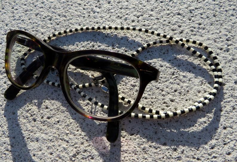 brownwhite Luxury finish redgrey redpink to enhance your frames Damier glasses cords in blackwhite French model.