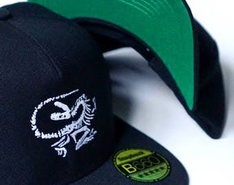 Dinosaur hat | Fossil Death Pose embroidered, Beechfield original, flat-peak, 5-panel snapback / cap 'DINO DEATH POSE', by Vector That Fox