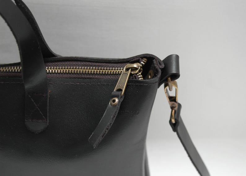black color,zip closure medium size Leather tote bag