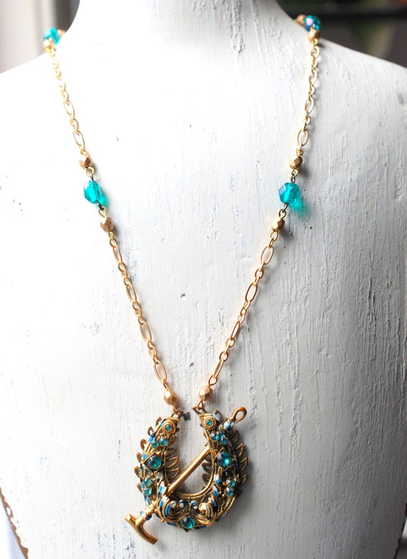 18-Inch Hamilton Gold Plated Necklace with 4mm Aqua Birthstone Beads and Gold Filled Saint Patrick Charm.