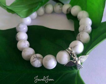 Bracelet made of natural cacholong white with color black streaks with a charm of 925 silver bird Pendant 10mm beads