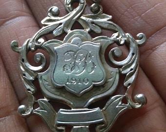 1910 Silver Medallion.