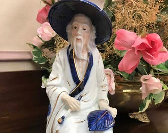 Vintage Toyo Japan Fine Porcelain man with Sugegasa, hat, pipe, and fan leaf
