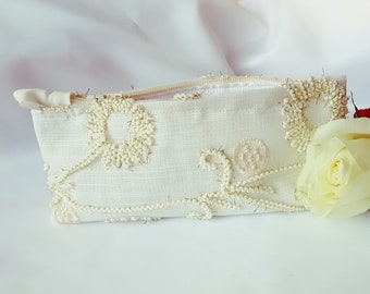 Beautiful Unique handmade cosmetic bag. Made with Moroccan fabric richly decorated with gold patterns